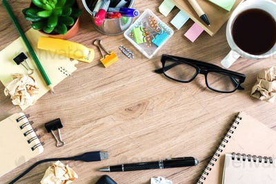 Messy Table with Blank Note and Tools