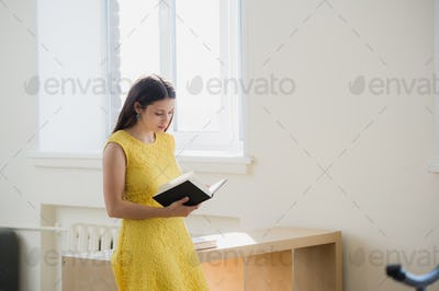 Happy young smiling student girl with book.