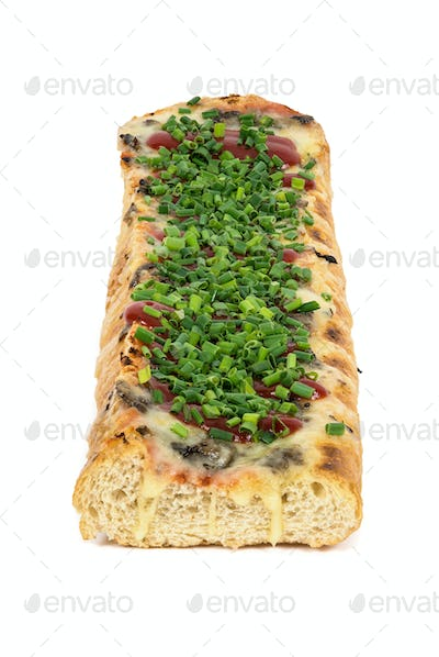 Polish toasted baguette with cheese and chive calles zapiekanka