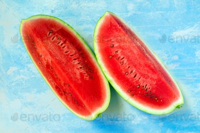 Watermelon slices on rustic blue wooden table