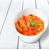 Chili con carne in white plastic plate isolated