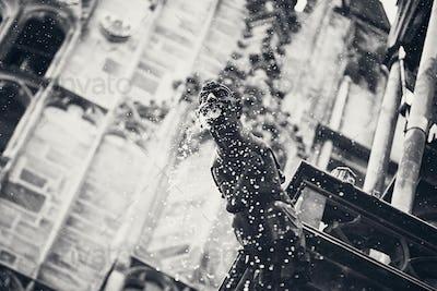 The spout figurine in rain