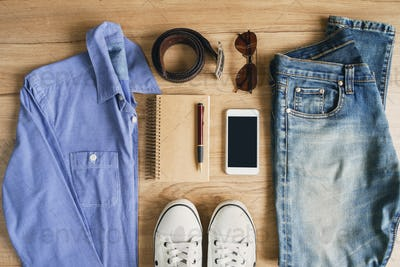 Flat lay of men casual fashion outfits on wooden background