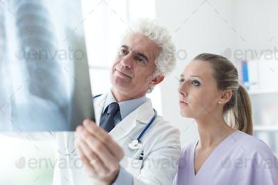 Doctors examining an x-ray image