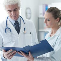 Doctor checking medical records