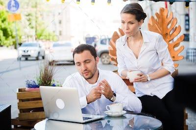 Man and Woman at outdoors Bar. Short Depth of Focus