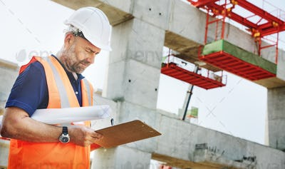 Construction Site Engineerer Working Blueprint