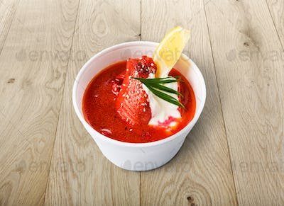 Food take away, russian soup borsch on wood