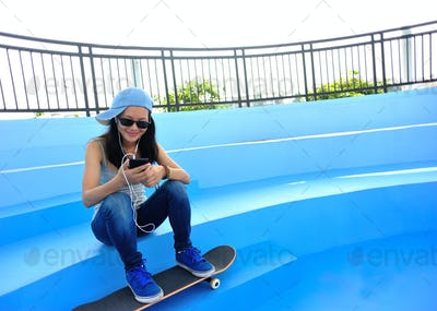 Woman listening player on skatepark