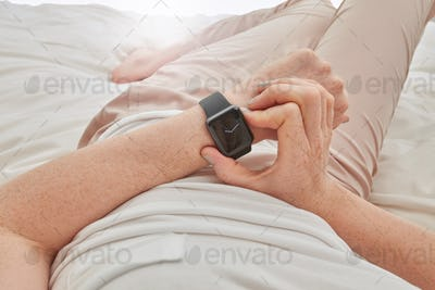 Woman using smartwatch to check time