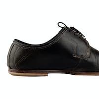 Old and elegant black shoe
