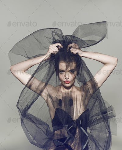 Fashion beautiful woman under the black veil