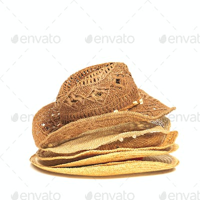 The lot of straw hats isolated on white background.