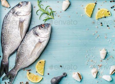 Fresh raw sea bream fish decorated with lemon