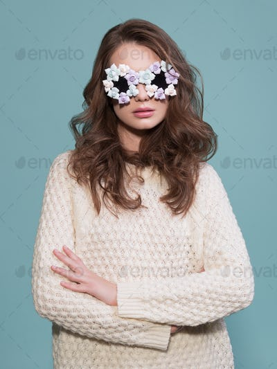 vogue art portrait of a stunning model in sunglasses in blue background