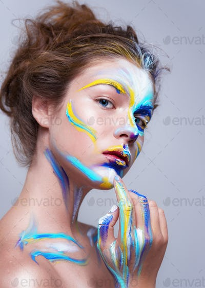 Painted beautiful woman face, artistic make up