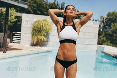 Fit young woman in swimwear at the poolside