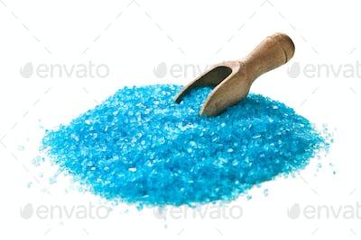blue bath salt with wooden scoop