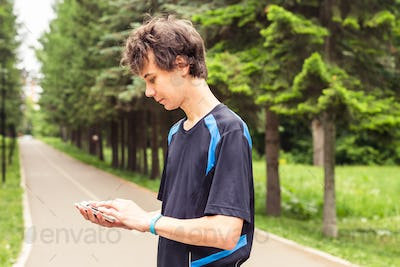 Man checking fitness and health tracking wearable device