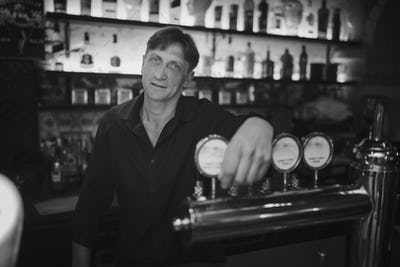 Barman at work in the pub