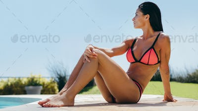 Sensual woman next to swimming pool