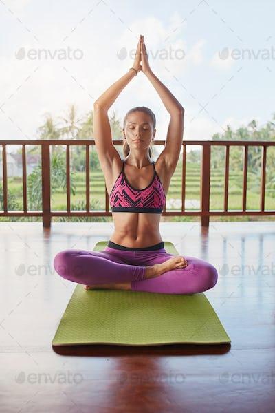Female model doing meditation yoga workout