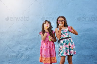 Cute little girls blowing soap bubbles