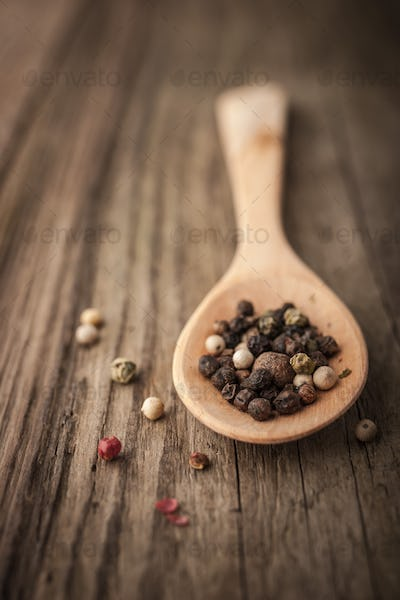 Pepper mix on the wooden spoon vertical