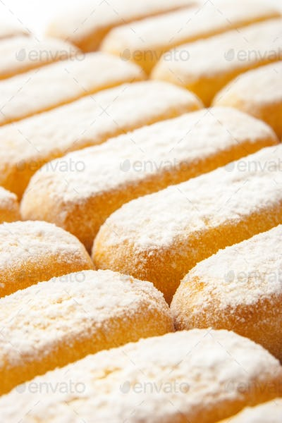 Cookies with powdered sugar background vertical