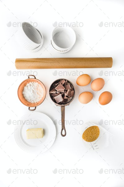 Ingredient for chocolate fondant on the white background vertical