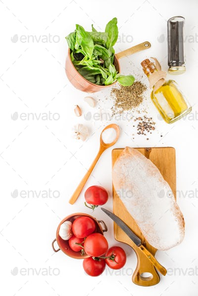 Ingredients for  bruschetta on the white background vertical