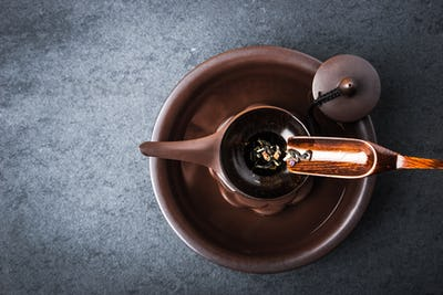 Kettle for tea ceremony on a blue stone table