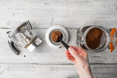 Making coffee set on the white wooden table top view