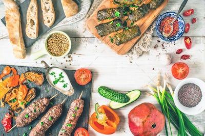 Kebabs with dolma, seasoning and vegetable.