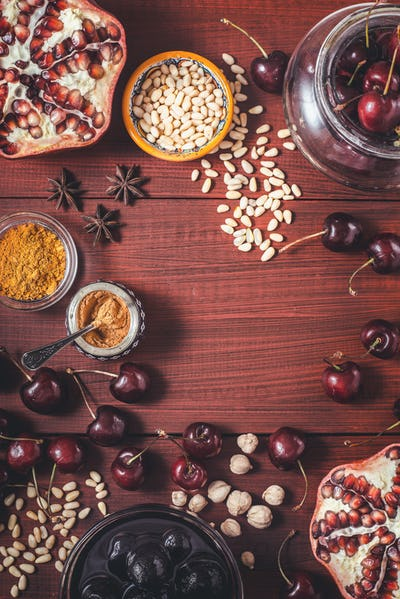Different fruit and spices on the red wooden table. Concept of oriental fruits