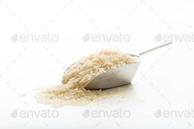 Raw basmati rice in a metallic scoop