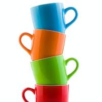 pile of colorful ceramic mugs