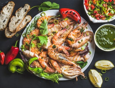 Plate of roasted tiger prawns and octopus