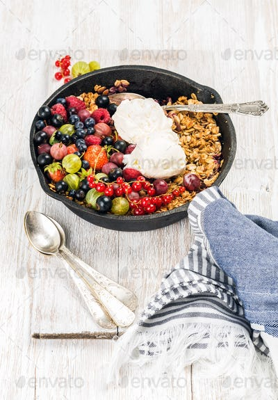 Oat granola crumble with berries, seeds and ice cream