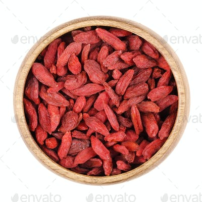 Goji berries in a bowl on white background