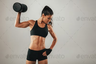 Toned muscular young woman working out
