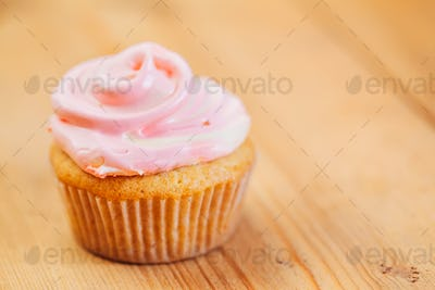 Dessert Sweet Gourmet Cupcake On Wooden Background