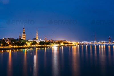 Cityscape At Evening Of Riga, Latvia. Night View With Blue Sky.