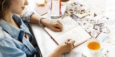 Girl Writing Diary Travel Memories Concept
