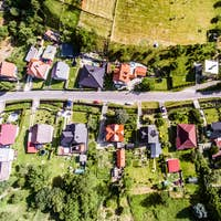 Aerial view of Dutch village, houses with gardens, green park