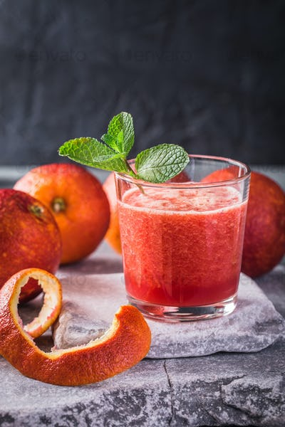 Blood orange fresh drink on stone background