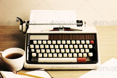 Vintage typewriter and coffee cup