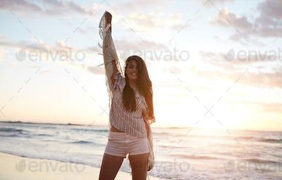 Beautiful female model having fun on the beach