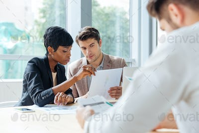 Group of business partners discussing ideas in conference room
