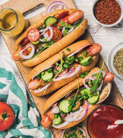 Homemade hot-dogs with vegetables, ketchup, mustard and spices